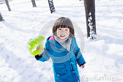 Girl happily playing in the Snow