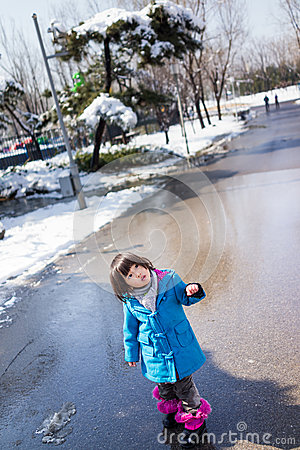 Girl happily walking on the road