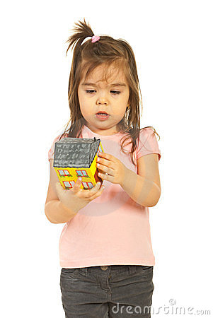 Little girl examine house