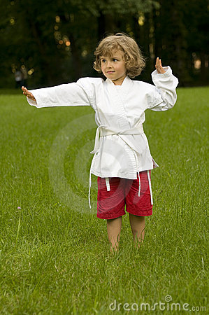 Little girl exercising in the garden