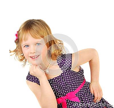 Little girl in fashion dress.