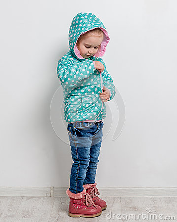 Free Little Girl Fastening Her Blue Jacket Stock Photo - 87927210
