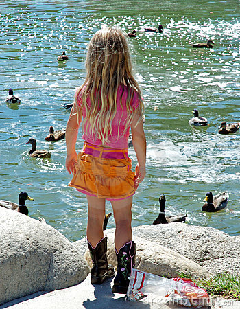 Little girl feeding ducks 1