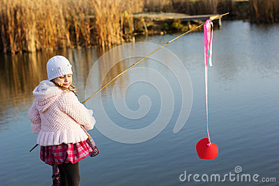 Little girl fishing from dock on lake stock photo image for Little girl fishing pole
