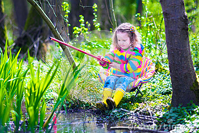 Little girl fishing in a forest stock photo image 53111557 for Little kid fishing pole