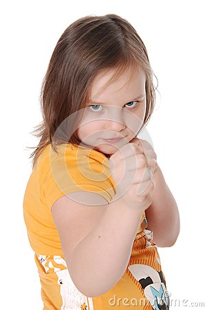 Little girl with fists, white background