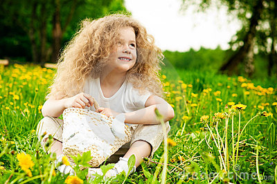 Little girl on flower field