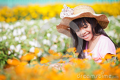 Little girl on flower filed