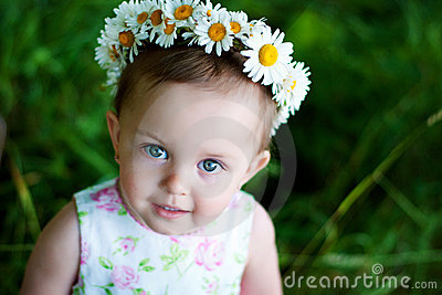 Little girl with flowers wreath