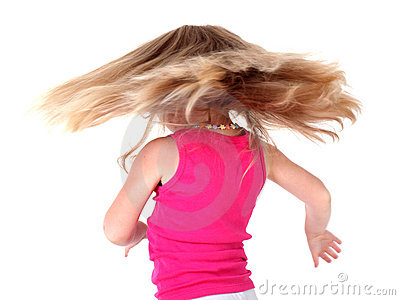 Little girl with flying hairs