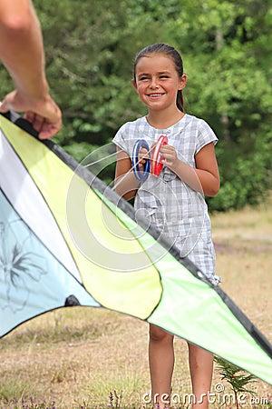 Little girl flying kite