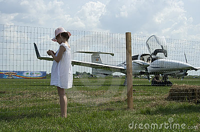 Little girl and flying machine, raw Editorial Photo