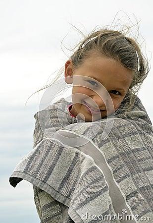 Little girl freezing but smiling
