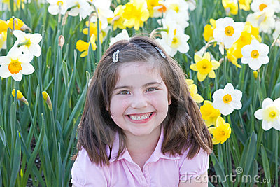 Little Girl in Front of Daffodils