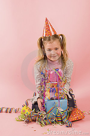Little girl in front of her present on her birtday