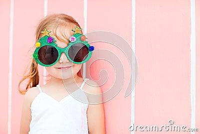 Little girl in funny Christmas glasses
