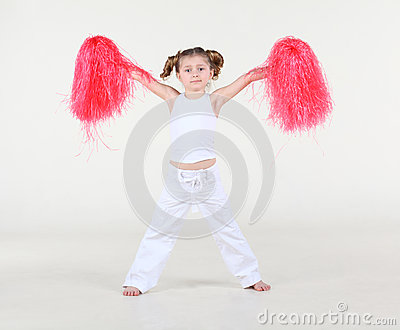 Little girl with funny hairdo holds in raised hands pompoms