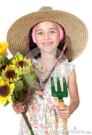 Little girl gardener with straw hat