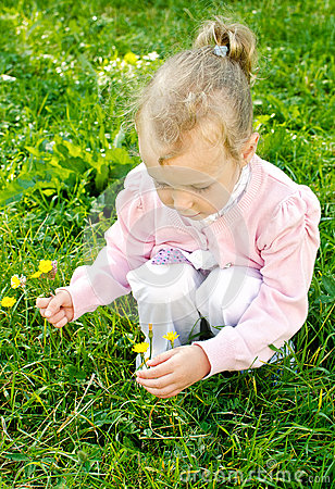 Free Little Girl Gathering Flowers Royalty Free Stock Photos - 26280298