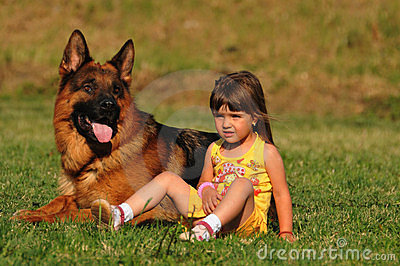 Little girl with german shepard