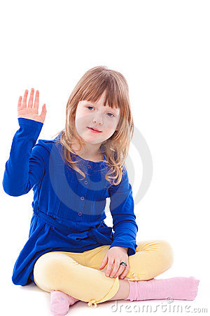 Little girl gesturing hello