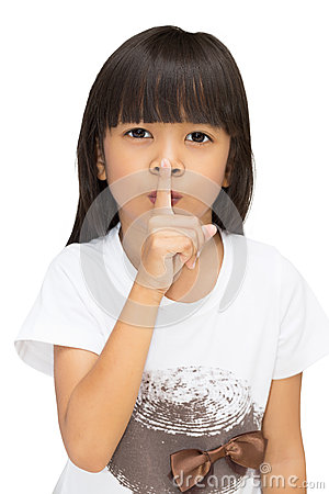 Little girl gesturing silence sign