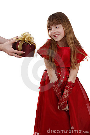 Little girl is getting gift. Girl feels shy.