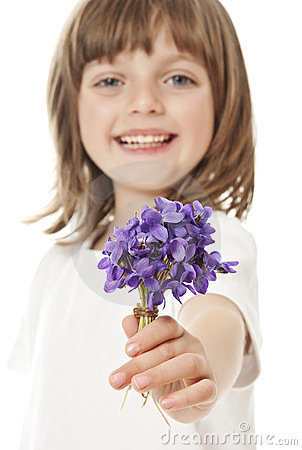 Little girl giving a bouquet