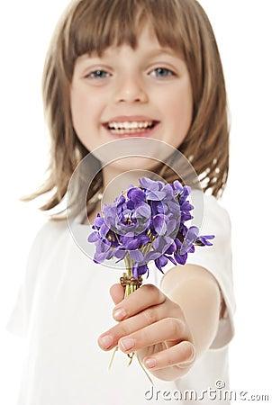Little girl giving a bouquet