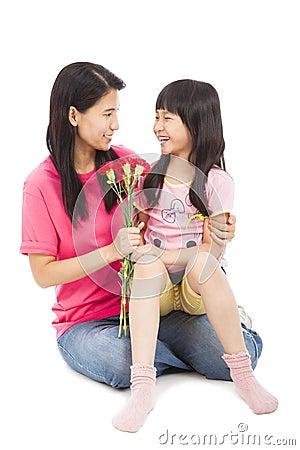 Little girl giving carnation flowers
