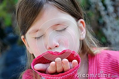 Little girl giving a hand kiss