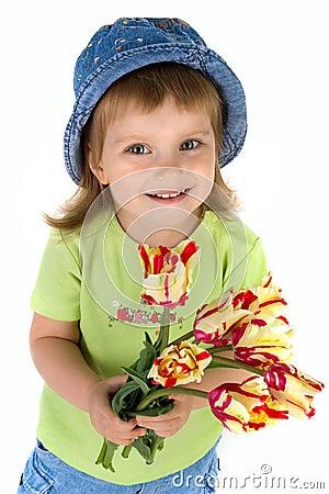 Little girl giving tulips