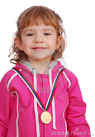 Little girl with golden medal winner