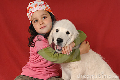 Little girl with a Golden retriever