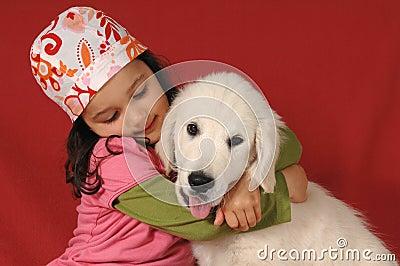 Little girl with a Golden retriever