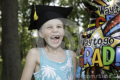 Little Girl Graduates Kindergarten