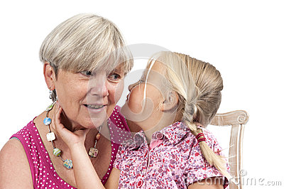 Little girl with grandmother on white