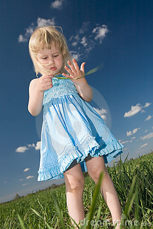 Little girl with grass in hands