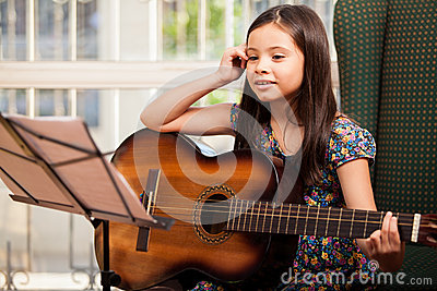 Little girl during a guitar lesson