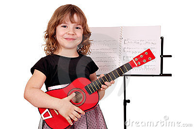 Little girl with guitar posing