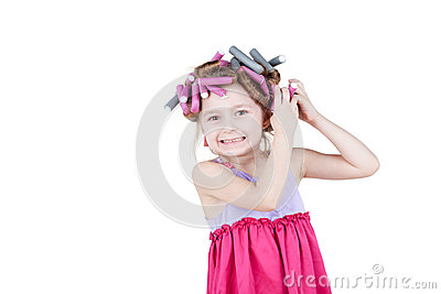 Little girl with  hair-curlers in her hair