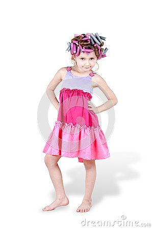 Little girl with hair-curlers in her hair poses