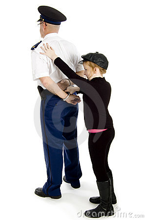Little girl is handcuffing a police officer