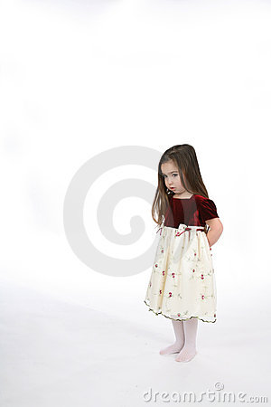 Little girl with hands behind her back