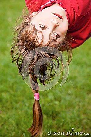 Little girl hanging upside-down