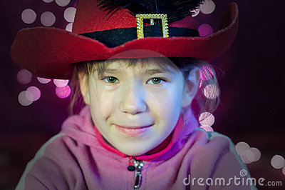 Little girl with hat look with Christmas lights
