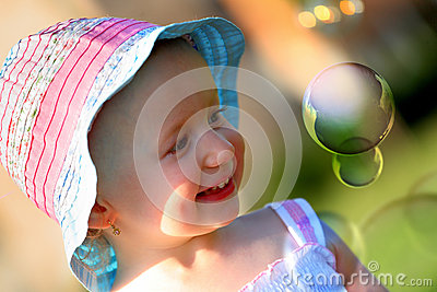 Little girl having fun with some soap bubbles