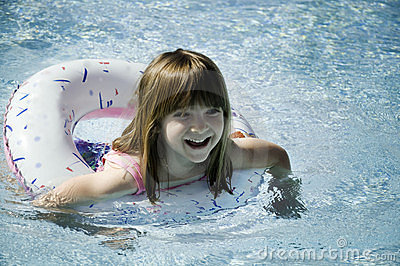 Little Girl Having Fun Swimming in the Pool