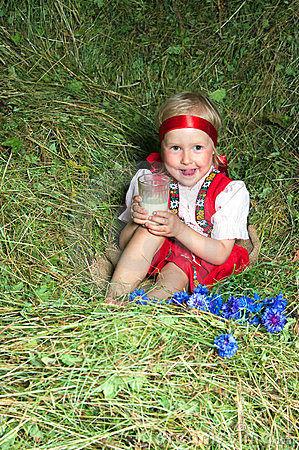 The little girl  on hay