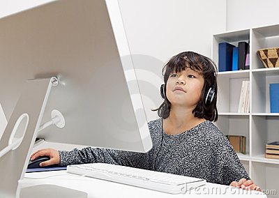 Little Girl with Headphones at Computer